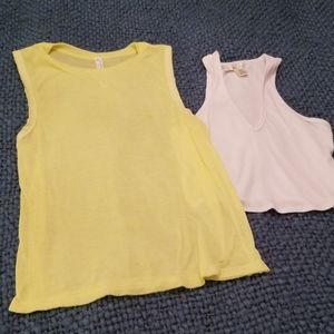 2 tank tops , one of them is free people